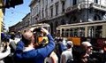 L'auto della polizia incastrata tra due tram, davanti alla Scala 'lo spettacolo' è in strada